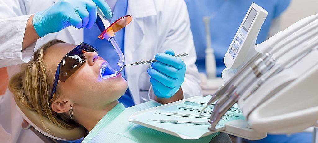 dentist performing teeth whitening